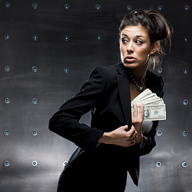 businesswoman holding a wad of cash